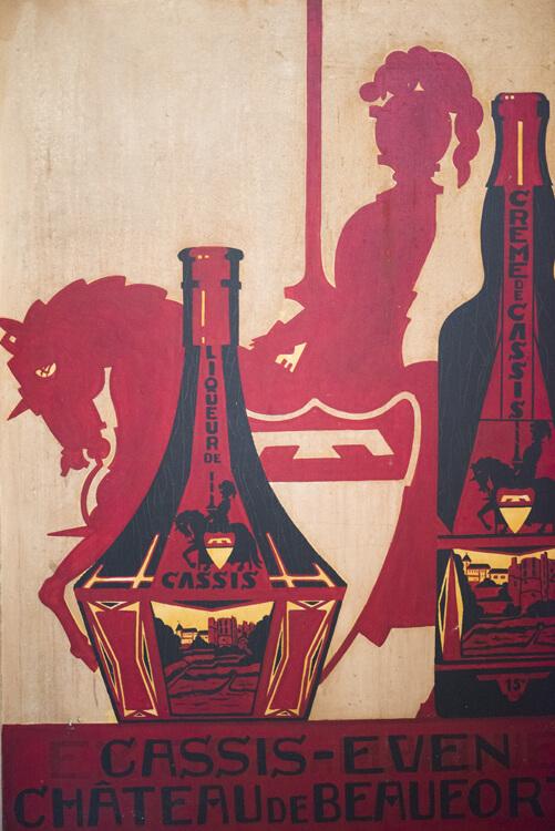Schildering van het logo en een fles Cassis de Beaufort